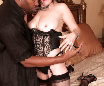 Older woman Debi greets a black stud for hard fuck wearing sexy lingerie