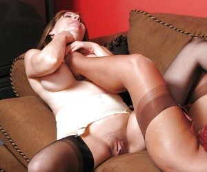 Fetish lesbians in stockings kissing and sucking each others toes
