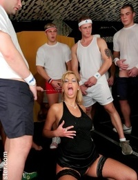 Blonde female Sheila B hikes her dress for sex before getting pissed on