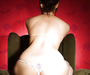 Foxy asian babe Haruka Yagami slipping off her suit and sheer lingerie