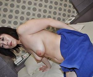 Asian lady Yumi Ohno has some nipples tweaking and pussy fingering fun