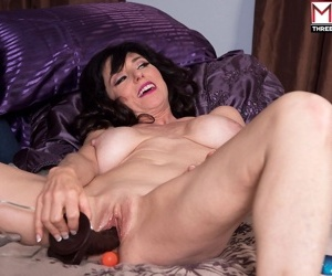 Busty cougar Karen Kougar invites a couple of boys to give her a DP