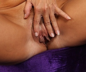 Older blonde woman Janet Darling playing with puffy labia lips