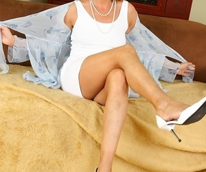 Cheating mature housewife strips off her dress before sex with her young lover