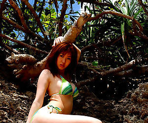 Busty asian babe Adusa Kyono slipping off her bikini outdoor