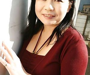 Sassy asian MILF Rumiko Shiga gets naked and has some pussy toying fun