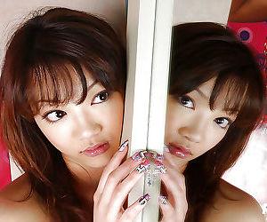 Stunning asian teen Mai Kitamura slipping off her top and panties