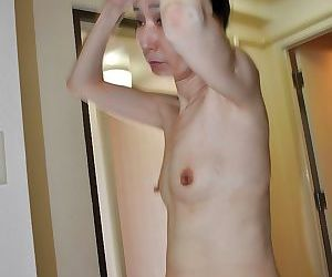 Slippy mature asian lady Nobue Toyoshima gives a blowjob after shower