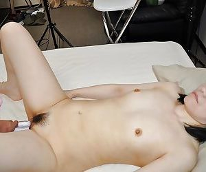 Asian gal Yoshie Tabata strips down and enjoys pussy toying and fingering