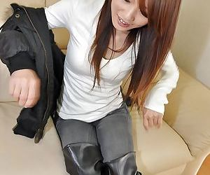 Asian sweetie lowers her jeans and panties and has some pussy toying fun