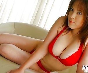 Stunning asian babe with big breasts stripping off her red lingerie
