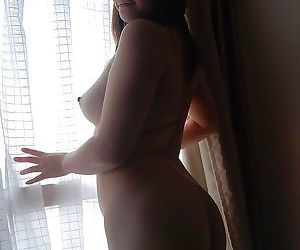 Chubby asian MILF Chisako Nimura strips down and gets her clit vibed