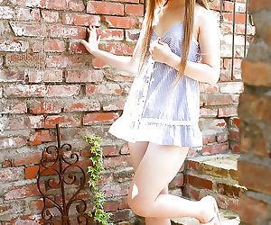 Stunning asian babe Ria Sakurai uncovering her graceful body outdoor