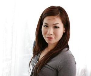 Lovely asian MILF Satoko Suda slowly uncovering her svelte curves