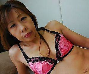 Asian MILF Aki Iwashita undressing and spreading her lower lips in close up