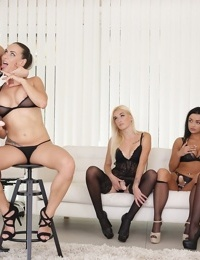 Lesbians in black lingerie get together for a strapon fuck in an all girl orgy