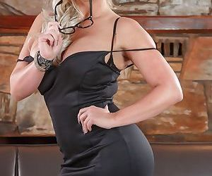 Thick blonde lady Phoenix Marie strips to black stockings and heels