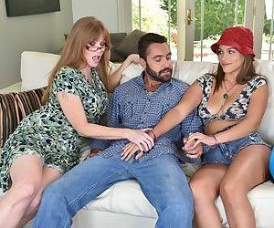 Thick older woman Marley Brinx has her stepdaughter help suck off a man