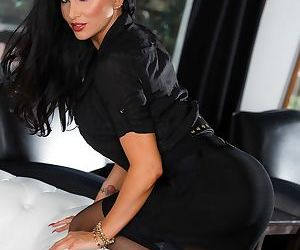 MILF Romi Rain in red lingerie and black stockings displays her big ass