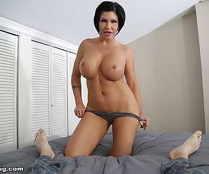 Short haired mom demonstrates her handjob technique while undressing