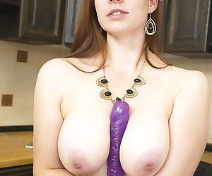 Busty hot mom strips naked in the kitchen to toy her horny pussy with a dildo