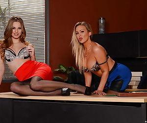 Office beauties Abbey Brooks and Jillian Janson on desk in pantyhose