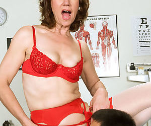Older nurse Elle Denay introduces a young boy to the joys of anal sex