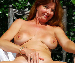 Older lady Dee Delmar pulls out her big boobs as she strips naked