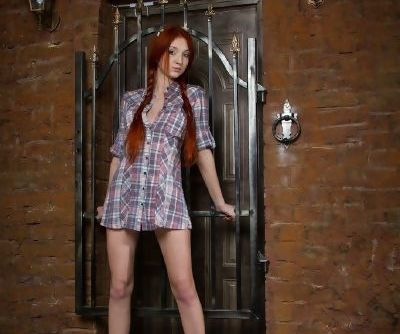 Pale teen Michelle H letting red hair free from pigtails while undressing