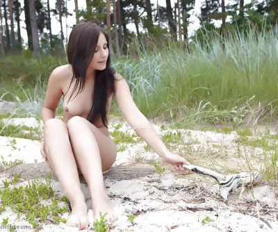 Cute young Vicky chilling on a rock naked with her legs spread & pussy bared