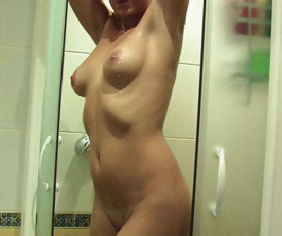 Shameless yet exceptionally fresh blonde babe rubs her pussy in shower