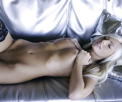 Platinum blondie Miranda Jordan looks awesome in lace stockings and with her pierced navel