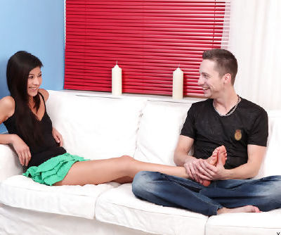 Happy and naked teen with good mood is satisfying her hungry partner indoors