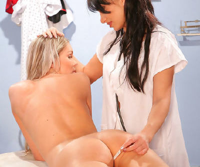 Naughty nurse Lea Lexis in uniform is fucking her babes pussy with strapon