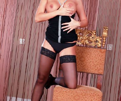 Glam chick in a little black dress sits her pussy on a big black dildo