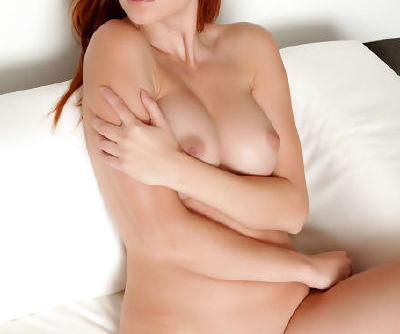 A nice strip of hair guides you to the young pussy of the sexy redheaded girl