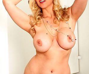 Hot blonde MILF strips off her dress and lingerie on restroom floor