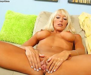 Busty mature vixen on high heels undressing and spreading her lower lips