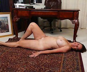 Older office worker Bobby Jackson undressing for spreading of shaved vagina