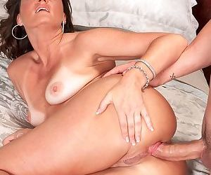 Warm sperm falls on the just fucked asshole of the excited MILF with tanlines