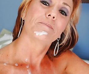 Busty mature lady in glasses gives a handjob and gets facialized