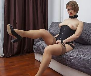 Collared blonde chick takes off her nylons before inserting ponytail dildo