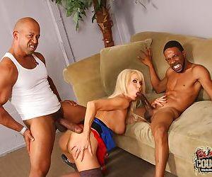Older blonde lady Erica Lauren takes on 2 big black dicks at once