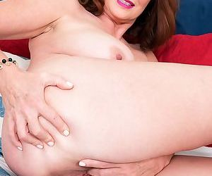 Beautiful horny mom Andi James fingers her hairy cunt in various positions