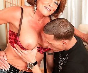 Redhead mature teacher Riley Wayne wants some anal from her student