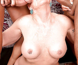 Short haired lady over 50 honey ray giving blowjobs in mmf threesome - part 1273