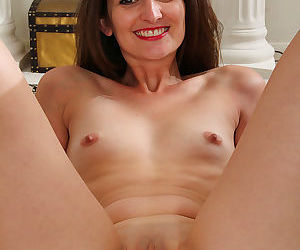 Slender mature victoria johnson in sheer lingerie spreading shaved pussy - part 1290