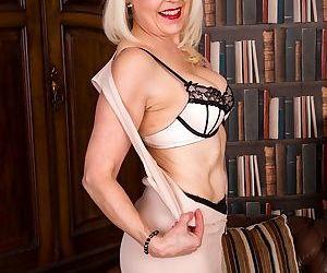 Mature blonde margaret holt posing naked in black stockings - part 1895