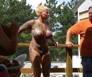 Busty tattoed and pierced mature poser on the public - part 421