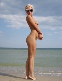 Amateur footage from the beach with naked young blonde girlfriend - part 2